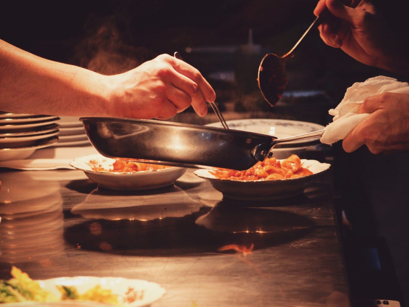 Food + Drink person food human action indoor dish meal cooking cuisine sense meat
