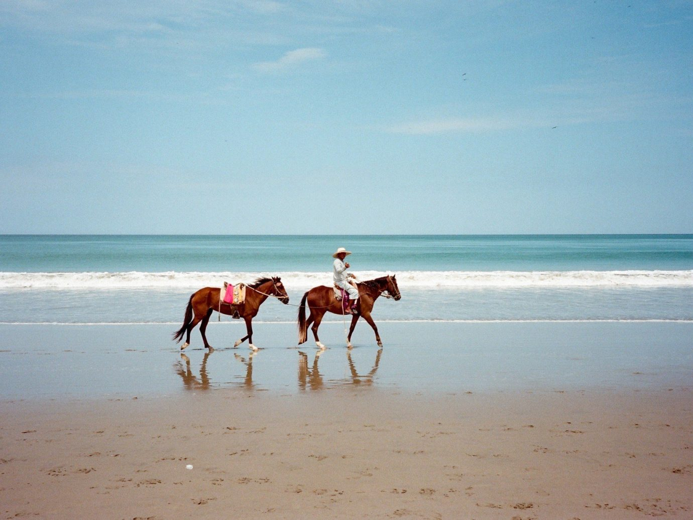 Travel Tips water outdoor Beach sky shore Sea body of water Nature Ocean vacation Coast horizon people sand wave cape sandy