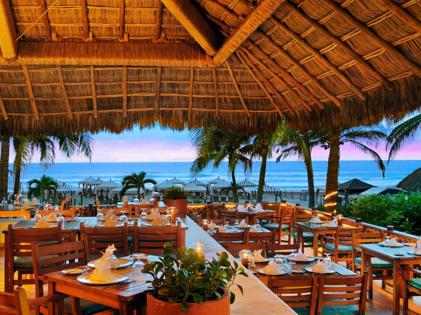Budget table umbrella outdoor chair Resort restaurant vacation estate meal Dining caribbean set several dining room