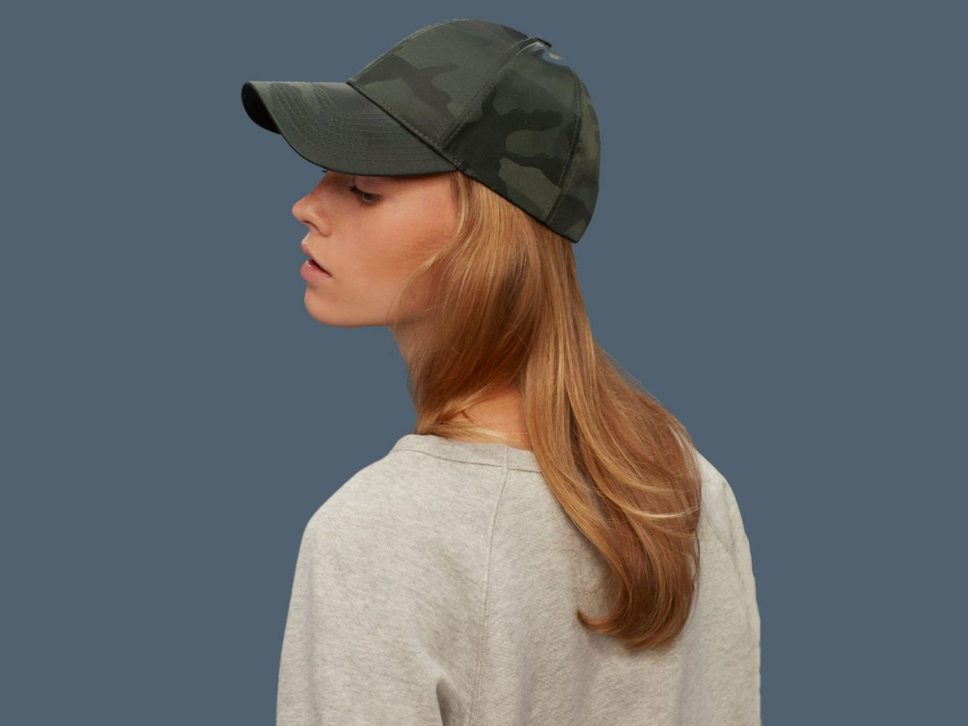 Style + Design person clothing hair cap wearing hat fashion accessory hairstyle headgear
