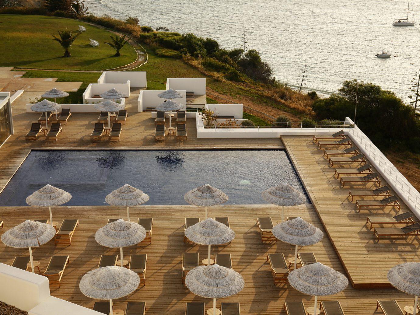 Boutique Hotels Health + Wellness Hotels Luxury Travel Romance Secret Getaways Spa Retreats Trip Ideas table outdoor grass water roof outdoor structure