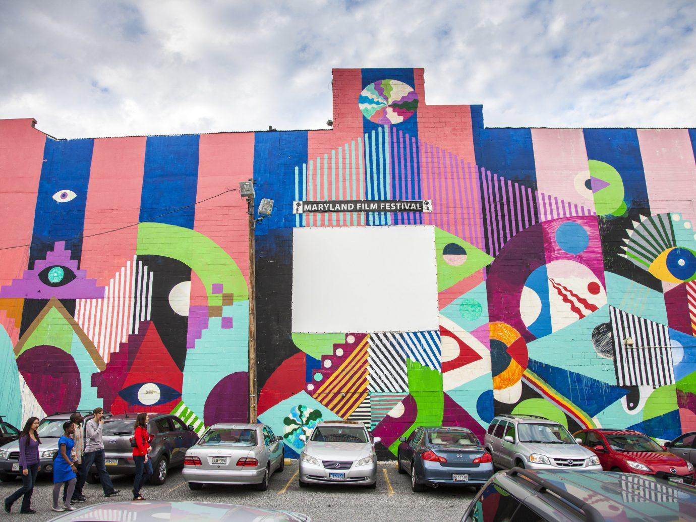 Romance Trip Ideas Weekend Getaways sky mural art wall street art graffiti flag colorful artwork