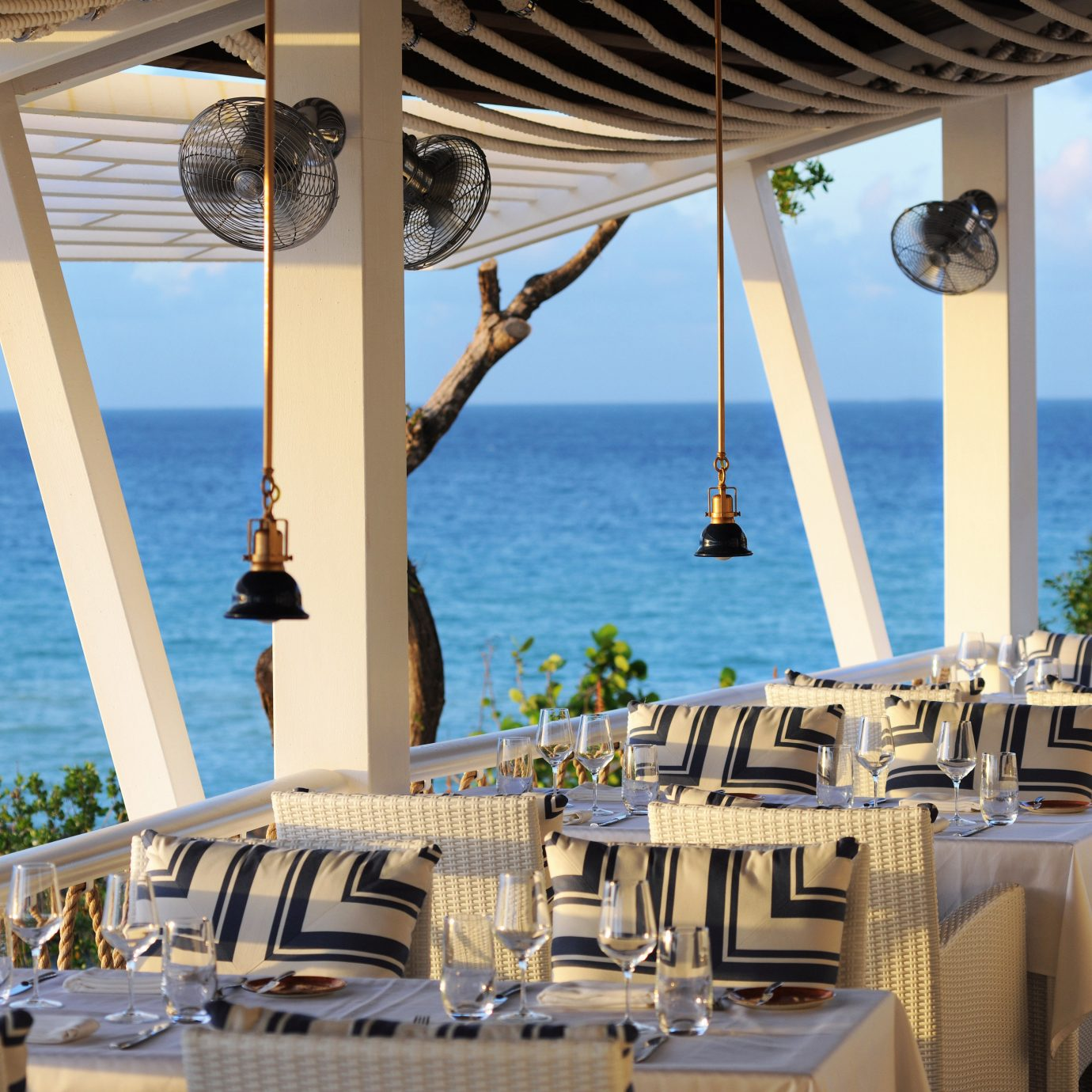 Balcony Beach Beachfront Cultural Dining Drink Eat Island Scenic views Waterfront water Boat Resort caribbean Deck restaurant yacht overlooking day