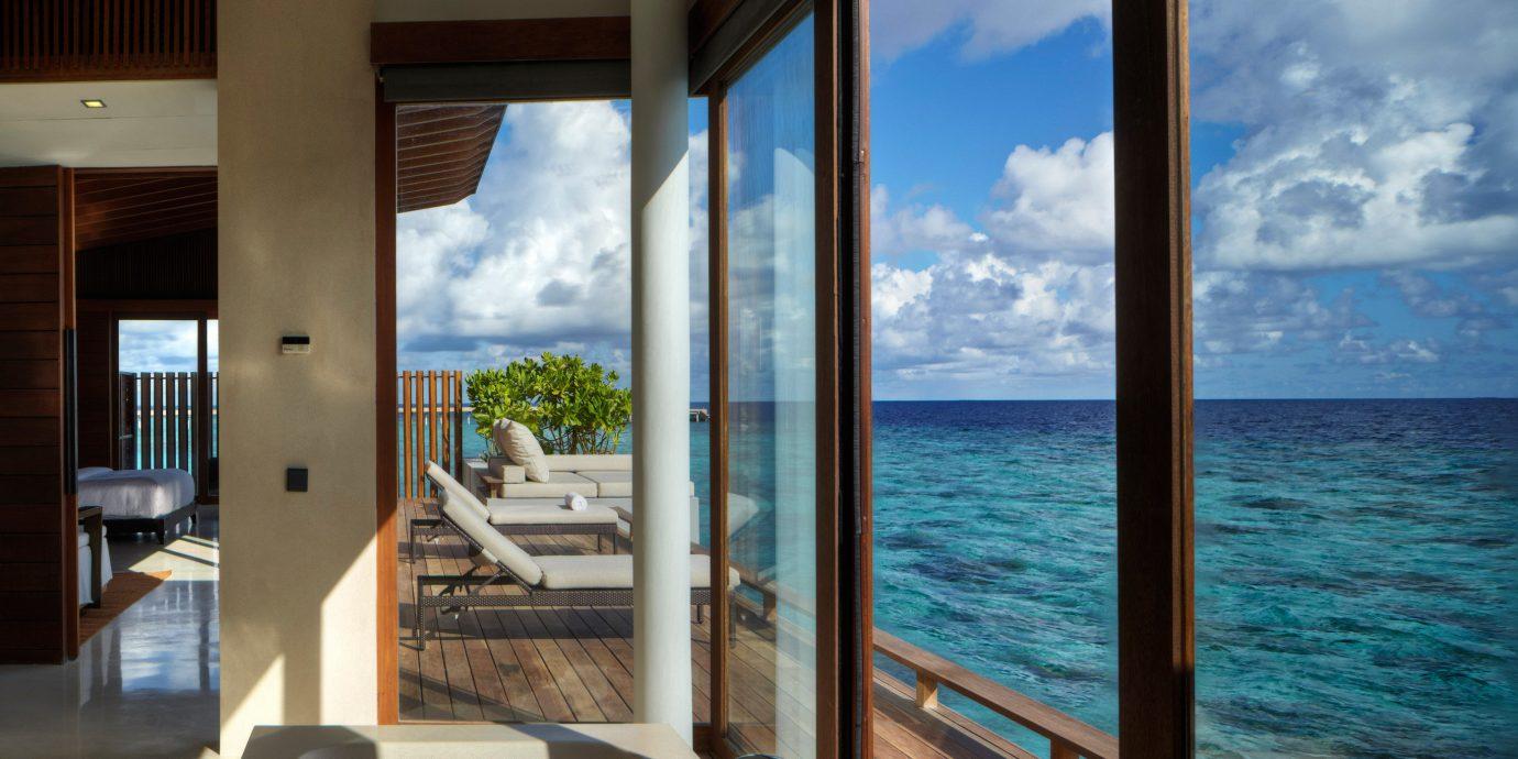 Balcony Beachfront Luxury Patio Resort Scenic views Villa water property overlooking house Ocean caribbean home condominium swimming pool
