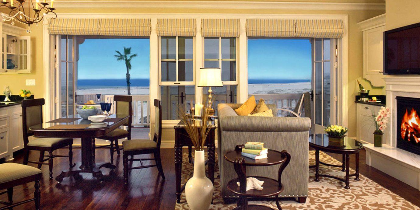 Balcony Bedroom Kitchen Lounge Ocean Suite Terrace Waterfront living room property home Fireplace hardwood mansion condominium cottage farmhouse Villa wood flooring