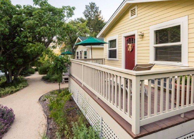 tree property building Deck home house outdoor structure siding porch cottage Balcony