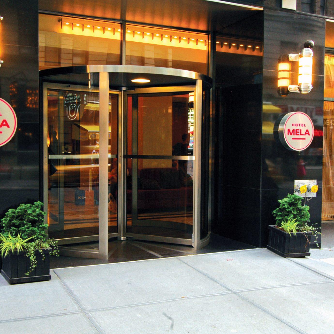 restaurant lighting street display window signage outdoor structure Bar door