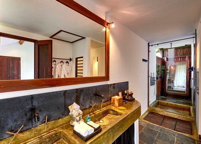 bathroom sink property mirror counter home hardwood Kitchen cottage Villa living room vanity mansion farmhouse Bar