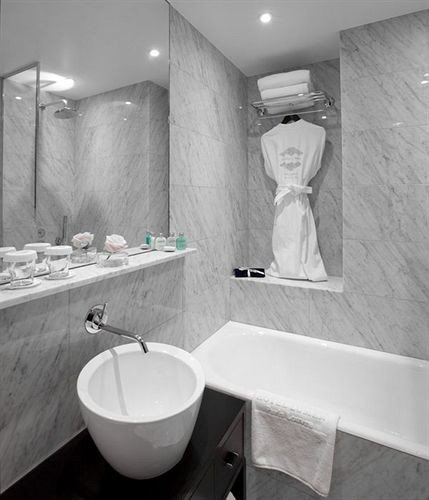 bathroom white bathtub plumbing fixture bidet sink toilet public toilet tub Bath