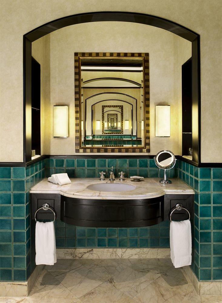 bathroom sink mirror property tiled tile home tub cabinetry countertop plumbing fixture flooring toilet bathtub Bath