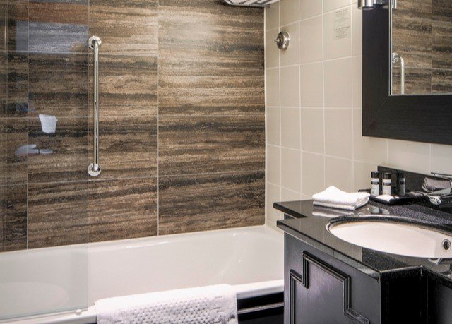 bathroom property countertop tile plumbing fixture sink flooring kitchen appliance tub stove Bath bathtub tiled