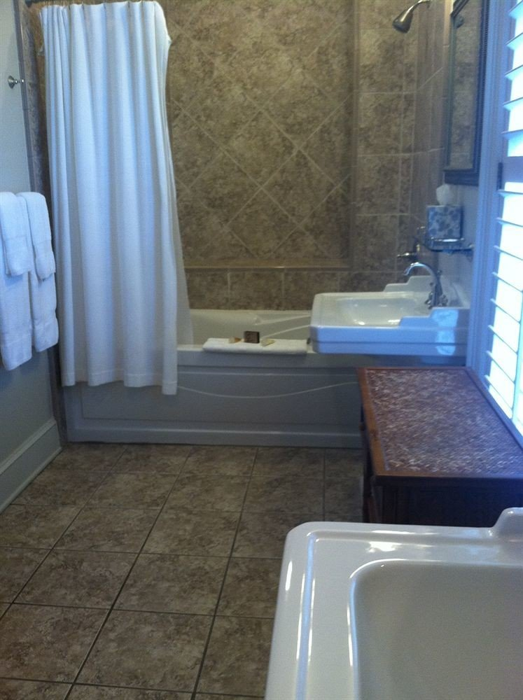 bathroom property curtain tub swimming pool flooring plumbing fixture tile home bathtub material Bath toilet tiled