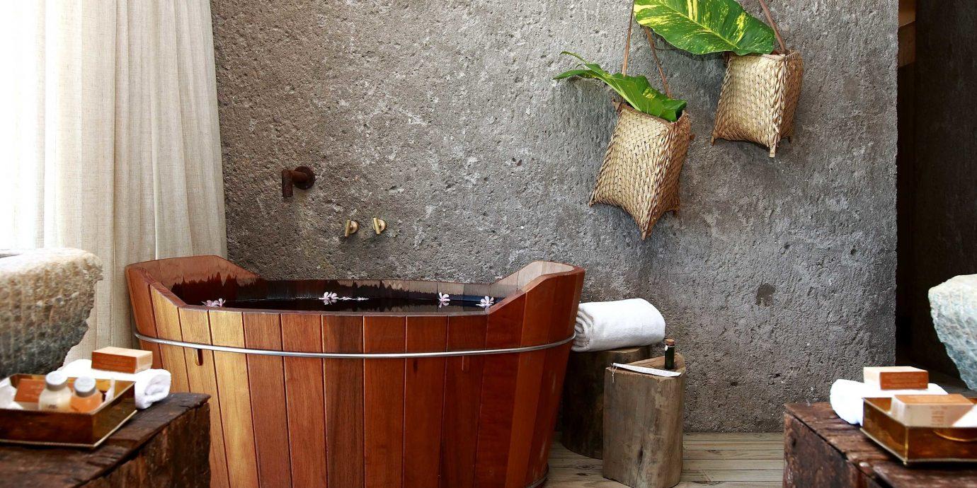 Bath Beach Beachfront Eco Modern Outdoors Patio Romantic Villa Waterfront man made object bathroom plumbing fixture wooden home bathtub cottage flooring sink
