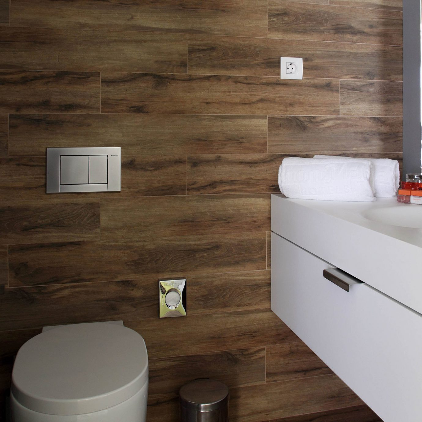 Bath Boutique Hip Modern bathroom property countertop hardwood home flooring Kitchen tile plumbing fixture cabinetry cottage