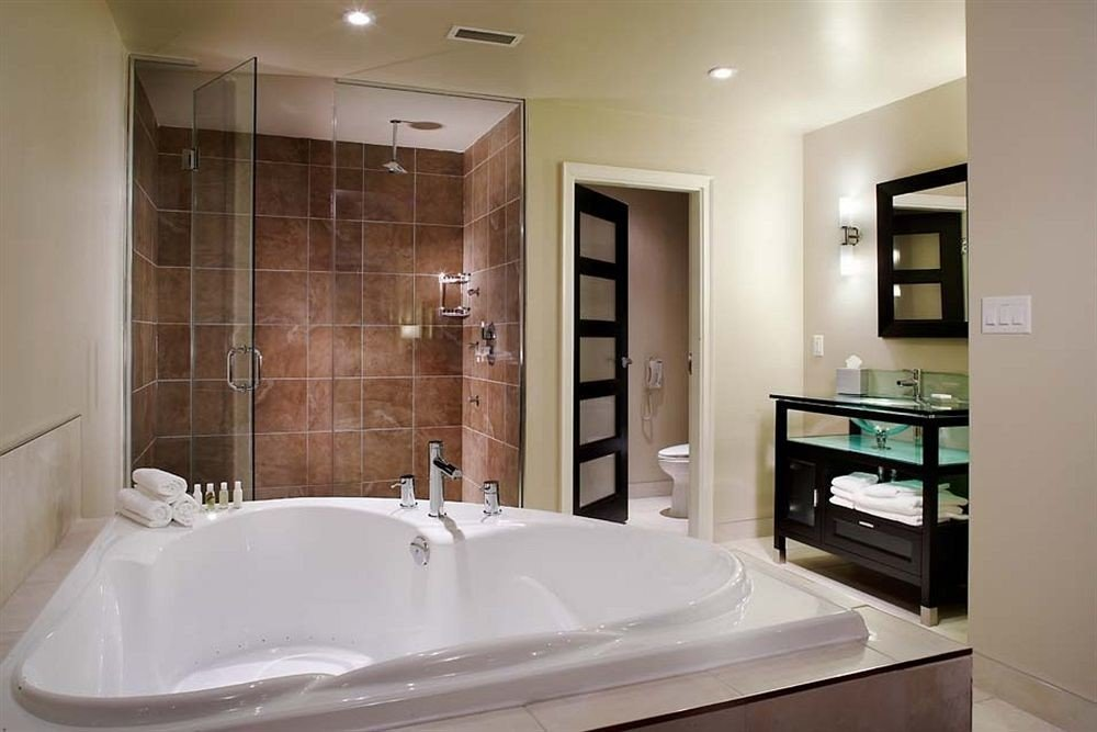 bathroom sink property vessel bathtub home plumbing fixture Suite flooring tub tile tan Bath