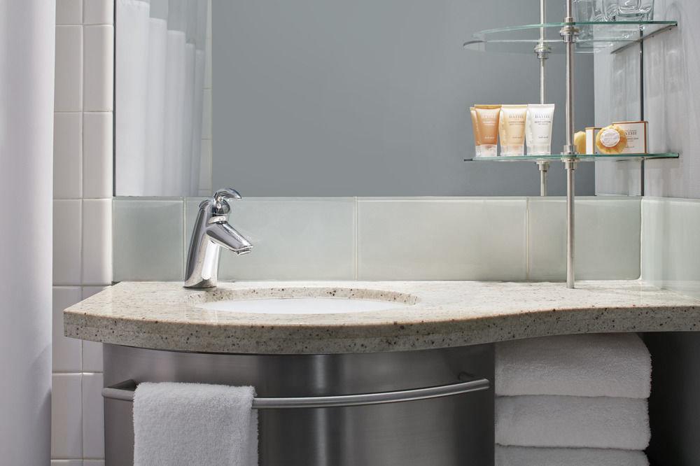 bathroom sink plumbing fixture bidet bathtub tile bathroom cabinet flooring countertop tap