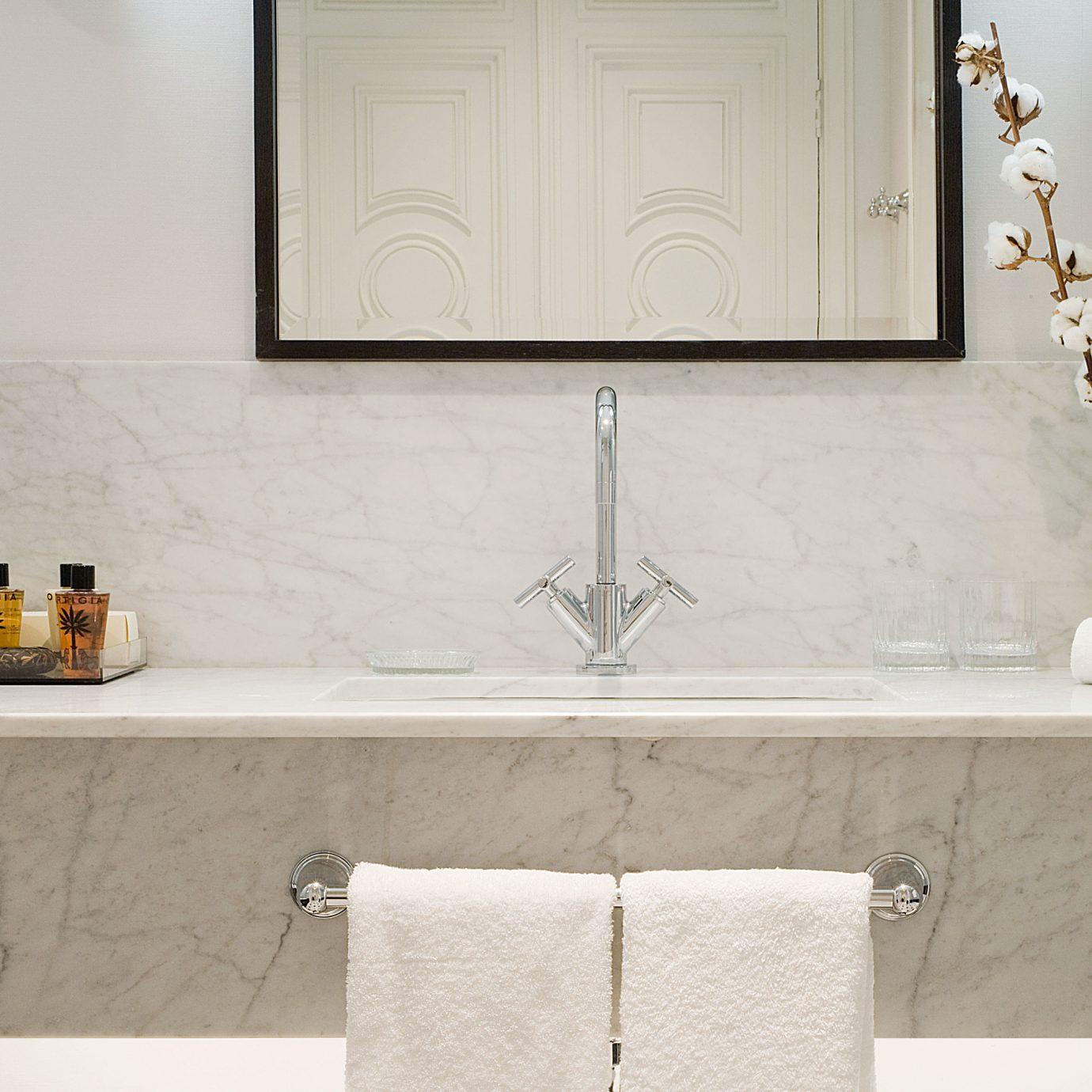 bathroom sink tile plumbing fixture countertop flooring bathtub home bathroom cabinet toilet