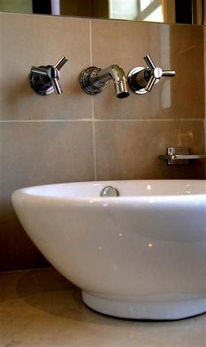 bathroom plumbing fixture sink bidet bathtub flooring ceramic tap tiled