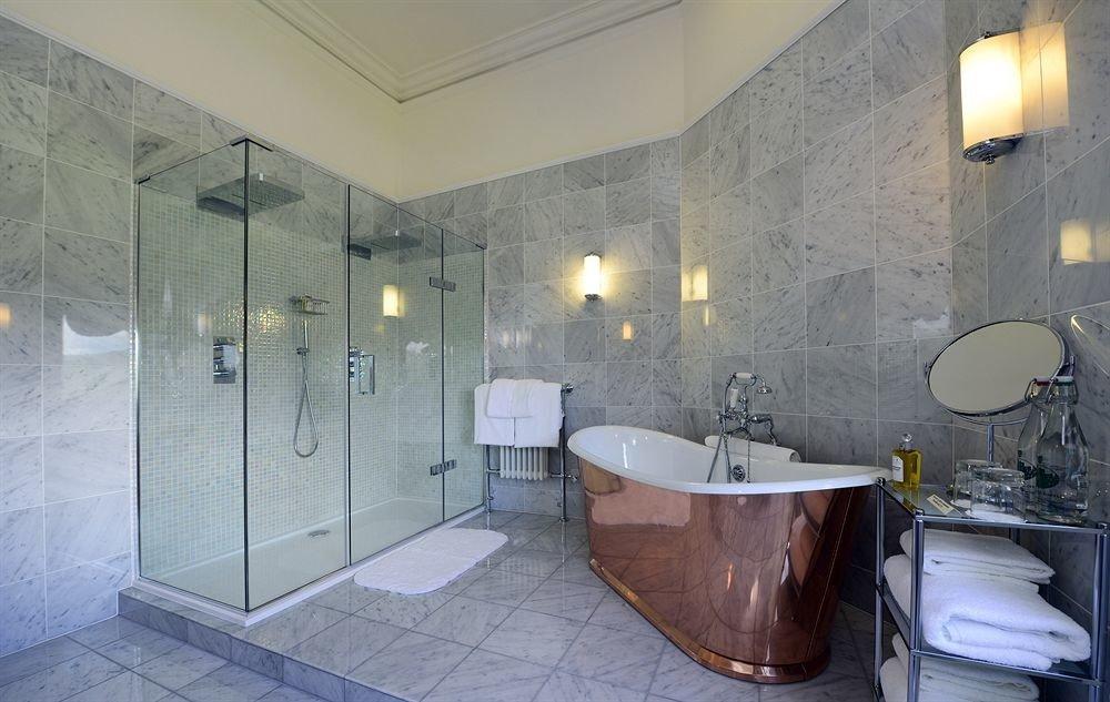 bathroom property sink bathtub plumbing fixture toilet tile tiled