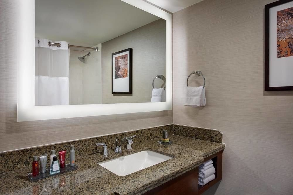 bathroom mirror sink property house home vanity towel counter cottage tourist attraction clean tan