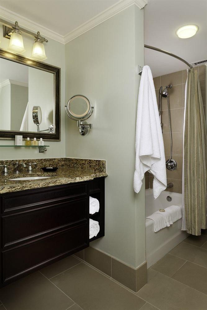 bathroom mirror sink property towel home flooring counter vanity rack plumbing fixture tile clean