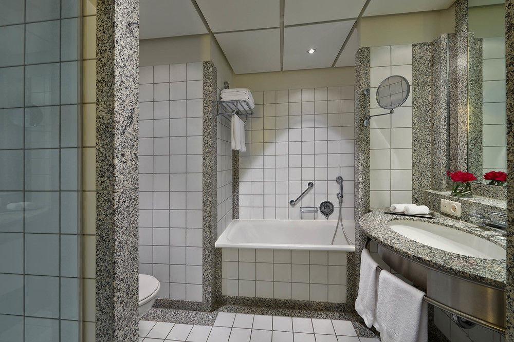 bathroom property toilet tile plumbing fixture home flooring tiled