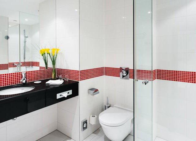 bathroom property white toilet plumbing fixture flooring tiled