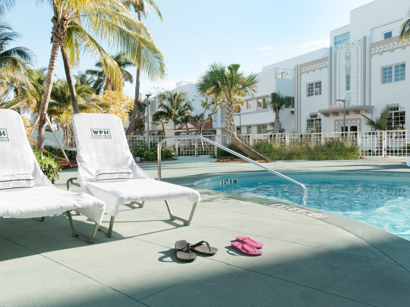 Boutique building Exterior Greenery Hotels lounge chairs Luxury outdoor pool palm trees Patio Pool Terrace trees Tropical Weekend Getaways tree outdoor sky leisure swimming pool property condominium vacation estate Resort caribbean Villa apartment
