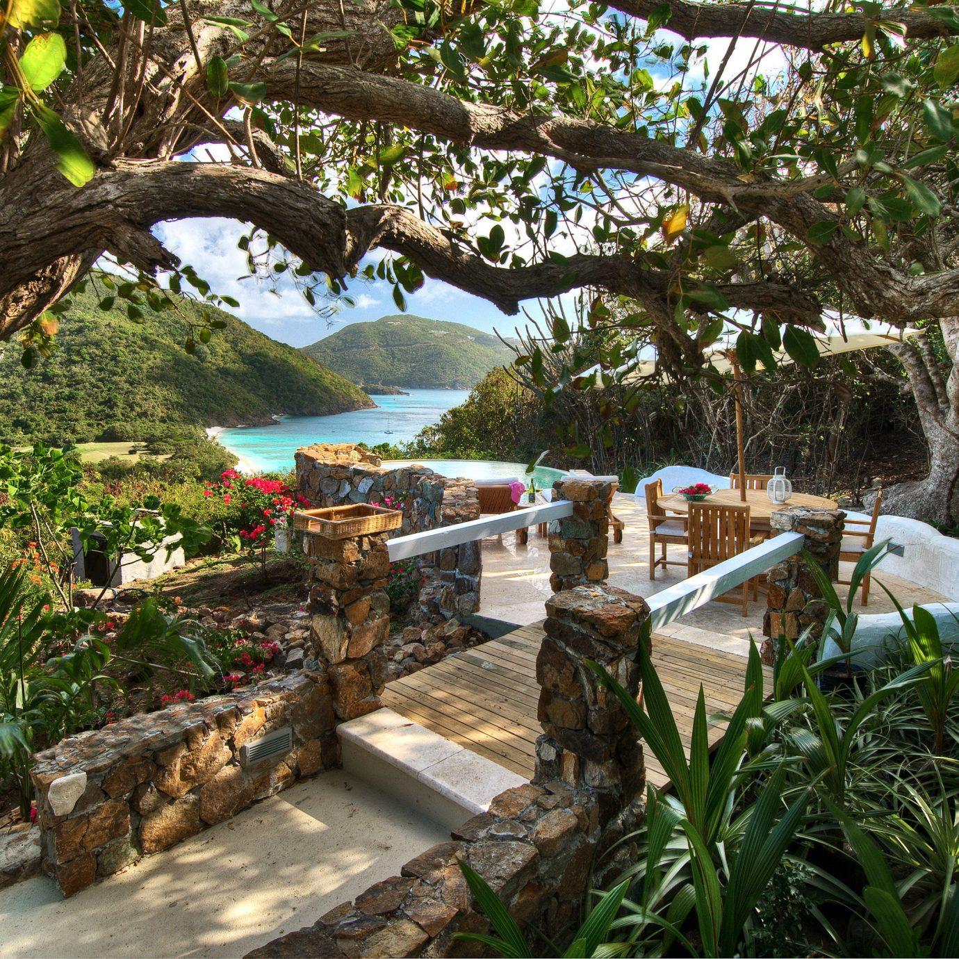 Beach Beachfront Classic Grounds Hotels Luxury Travel Scenic views Waterfront tree plant flora botany Resort Jungle Garden rainforest backyard tropics flower cottage