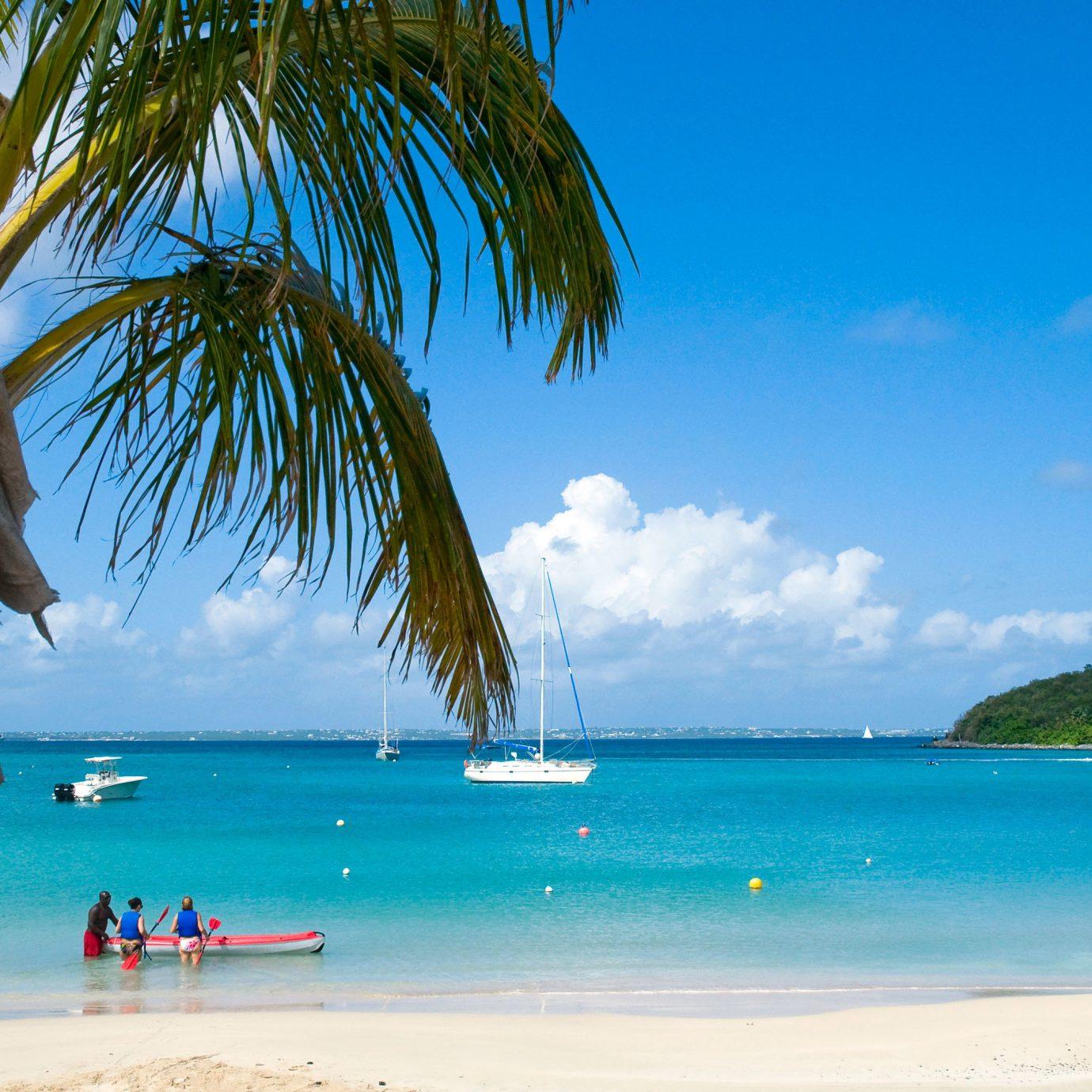 Beach Beachfront Lounge Luxury Ocean sky water tree Sea caribbean palm tropics shore arecales Coast palm family Island cape Lagoon plant sandy swimming day