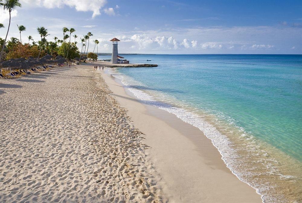 Beach Beachfront Lounge Luxury Ocean sky water Nature shore Sea Coast sand horizon wind wave wave cape material sandy day