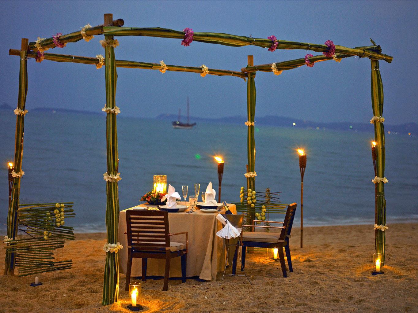Beach Beachfront Dining Drink Eat Luxury Romantic sky yellow evening lighting vehicle day
