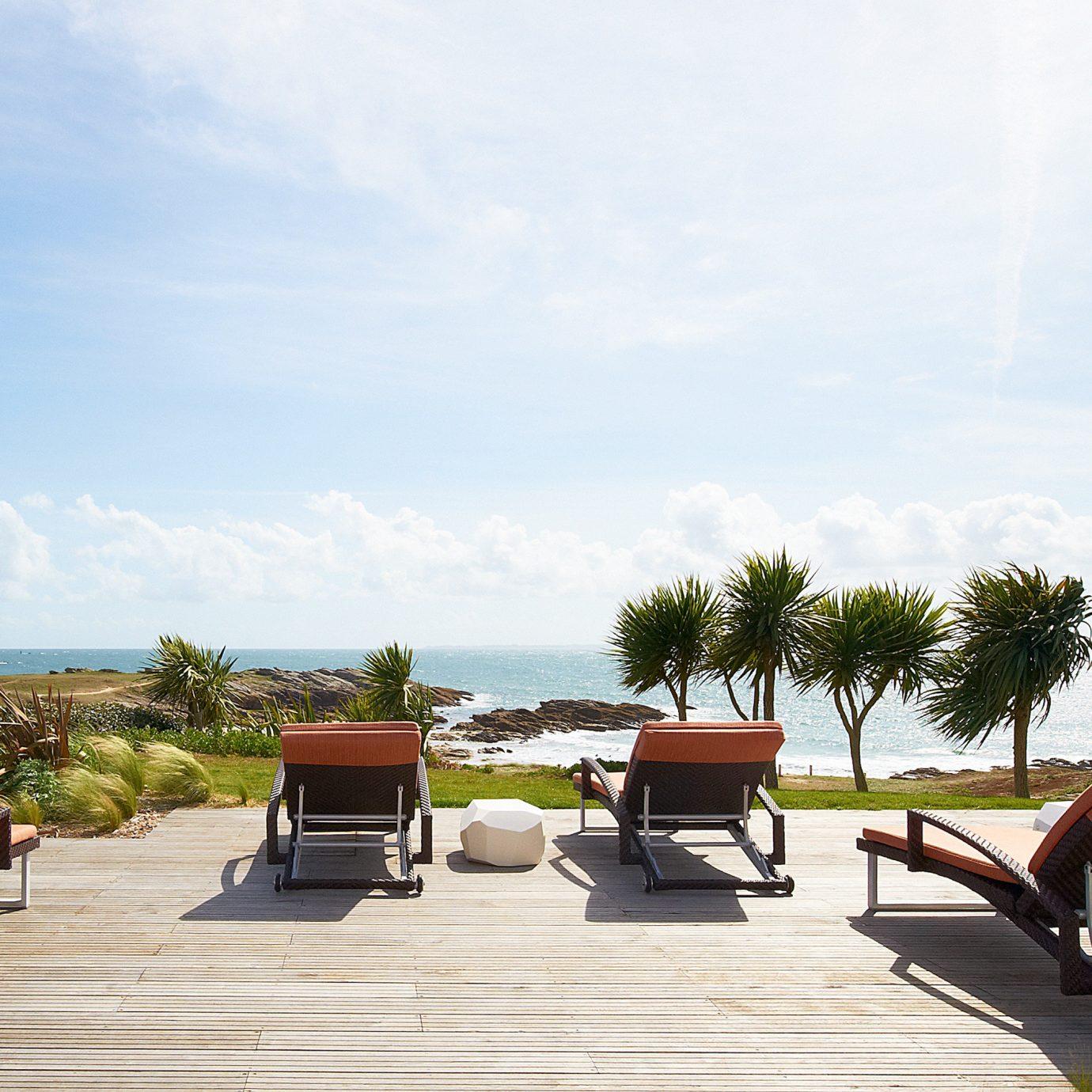 Beachfront Lounge Outdoors Patio Resort Scenic views sky ground property Beach walkway vehicle dock Villa Sea sandy