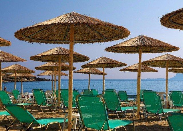 umbrella chair sky water lawn Beach leisure Resort set Sea Ocean green lined day line Boat shade