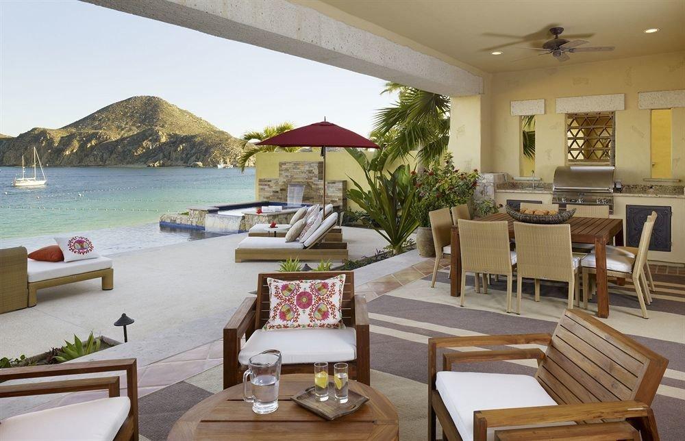 Beach Boutique Hot tub Hot tub/Jacuzzi Modern Scenic views Tropical property Resort Villa home living room restaurant condominium cottage Suite