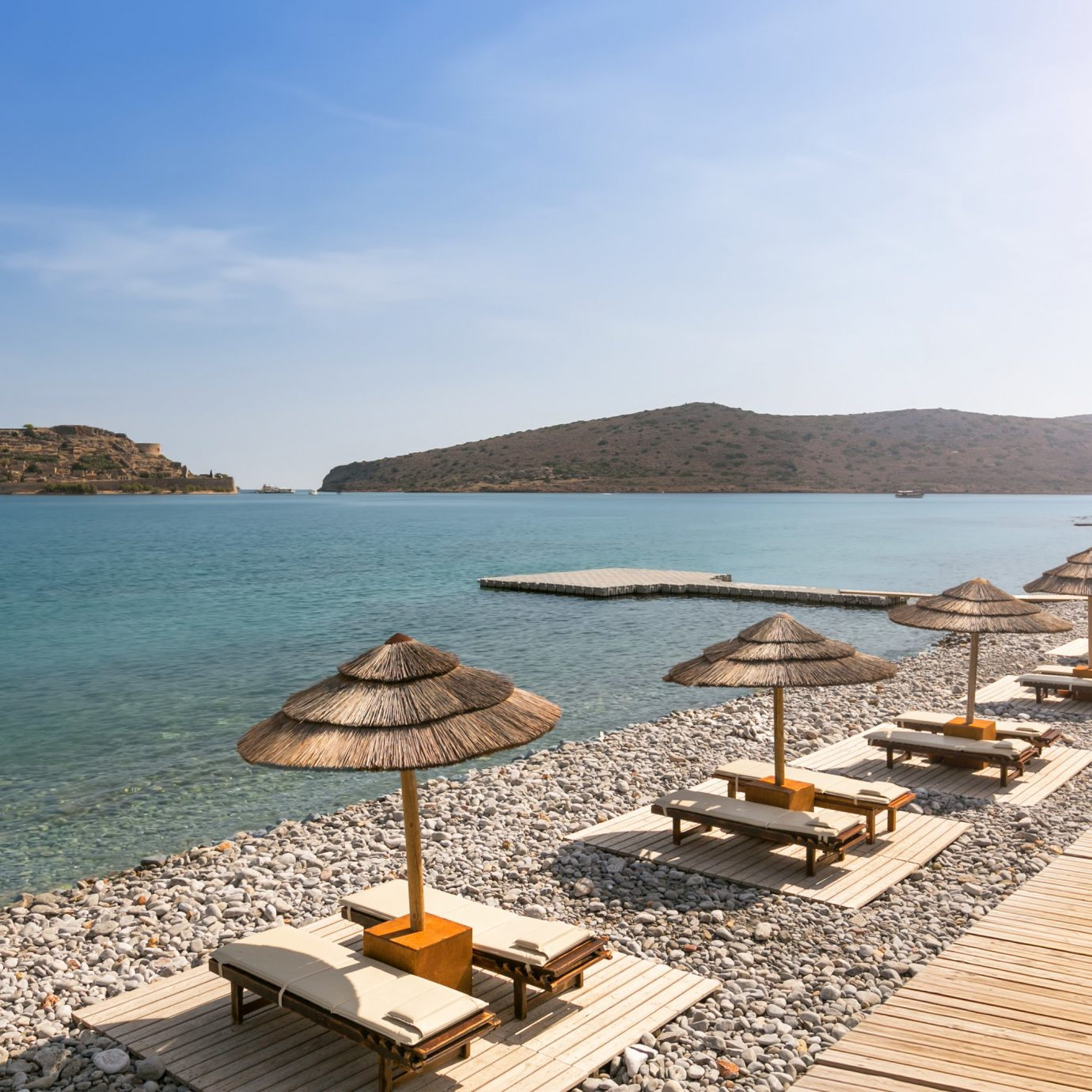 Hotels Romance sky water umbrella chair Beach Sea shore Coast Nature Ocean overlooking cape cove Resort marina dock Island set