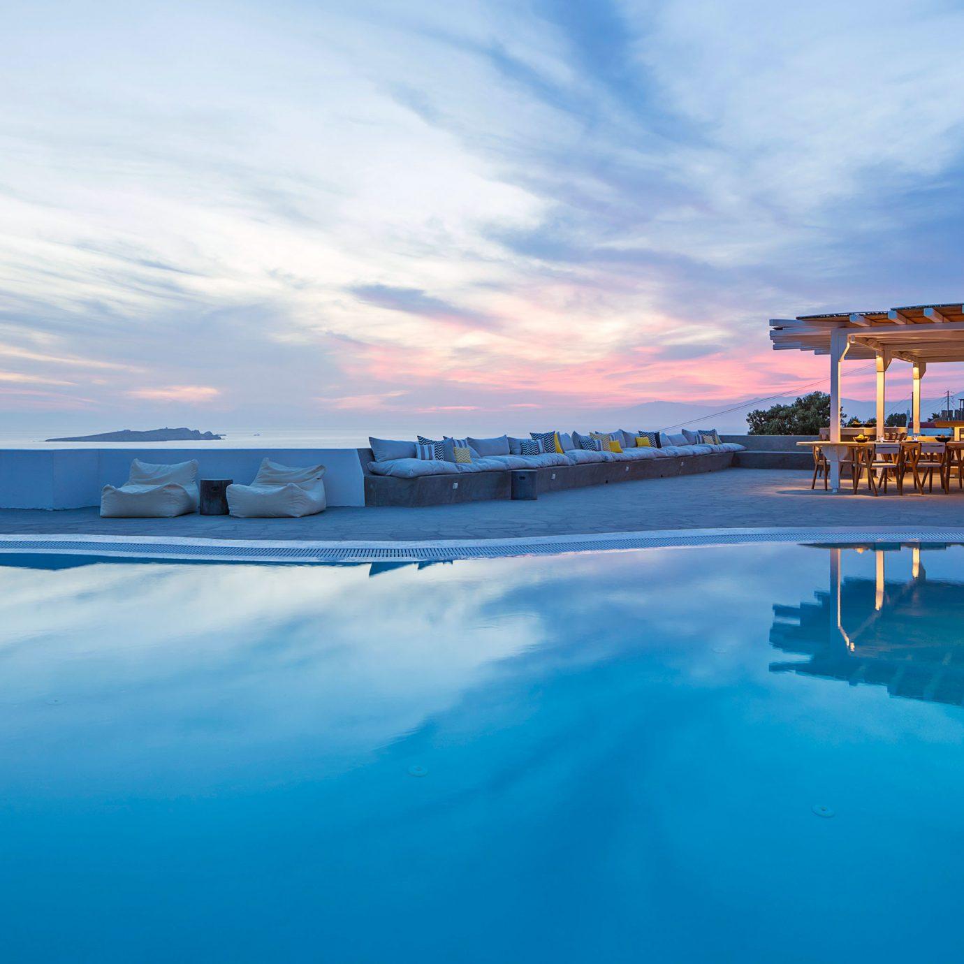 Hotels sky water Sea swimming pool Ocean scene horizon shore Coast dusk Beach blue day
