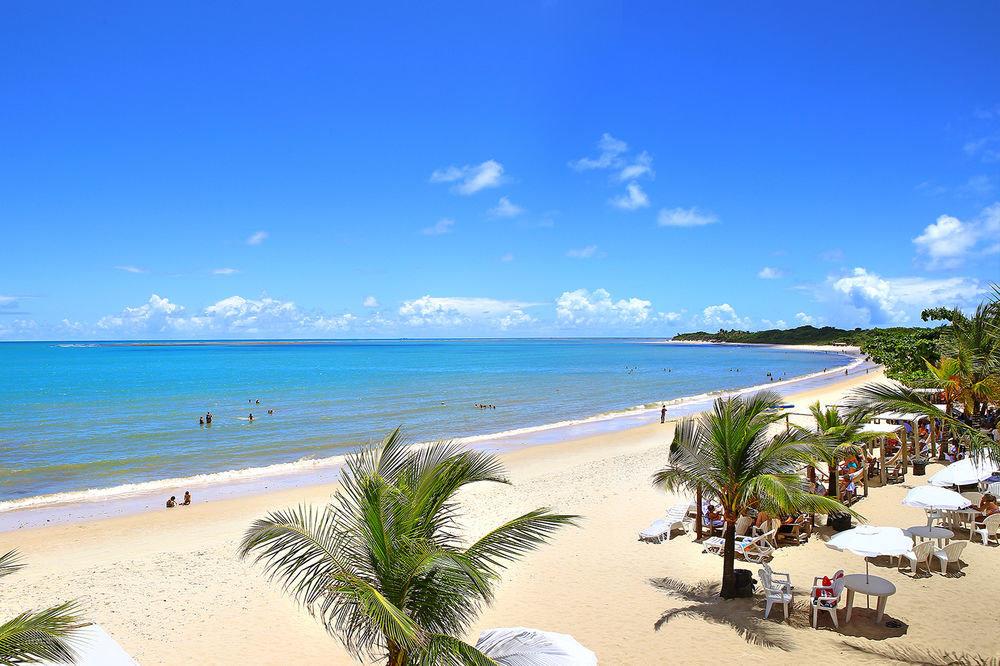 sky water Nature Beach shore Ocean Sea Coast caribbean Resort cape Lagoon sand tropics palm overlooking plant sandy