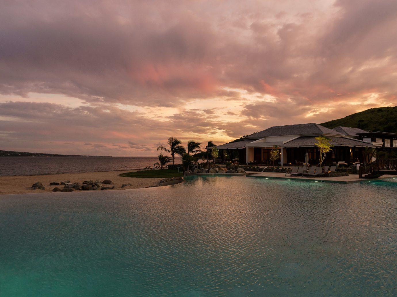 sky water Sea cloud Sunset horizon Ocean evening tropics clouds dusk shore Beach Coast Nature coastal and oceanic landforms caribbean calm sunrise cloudy dawn Lagoon landscape afterglow day