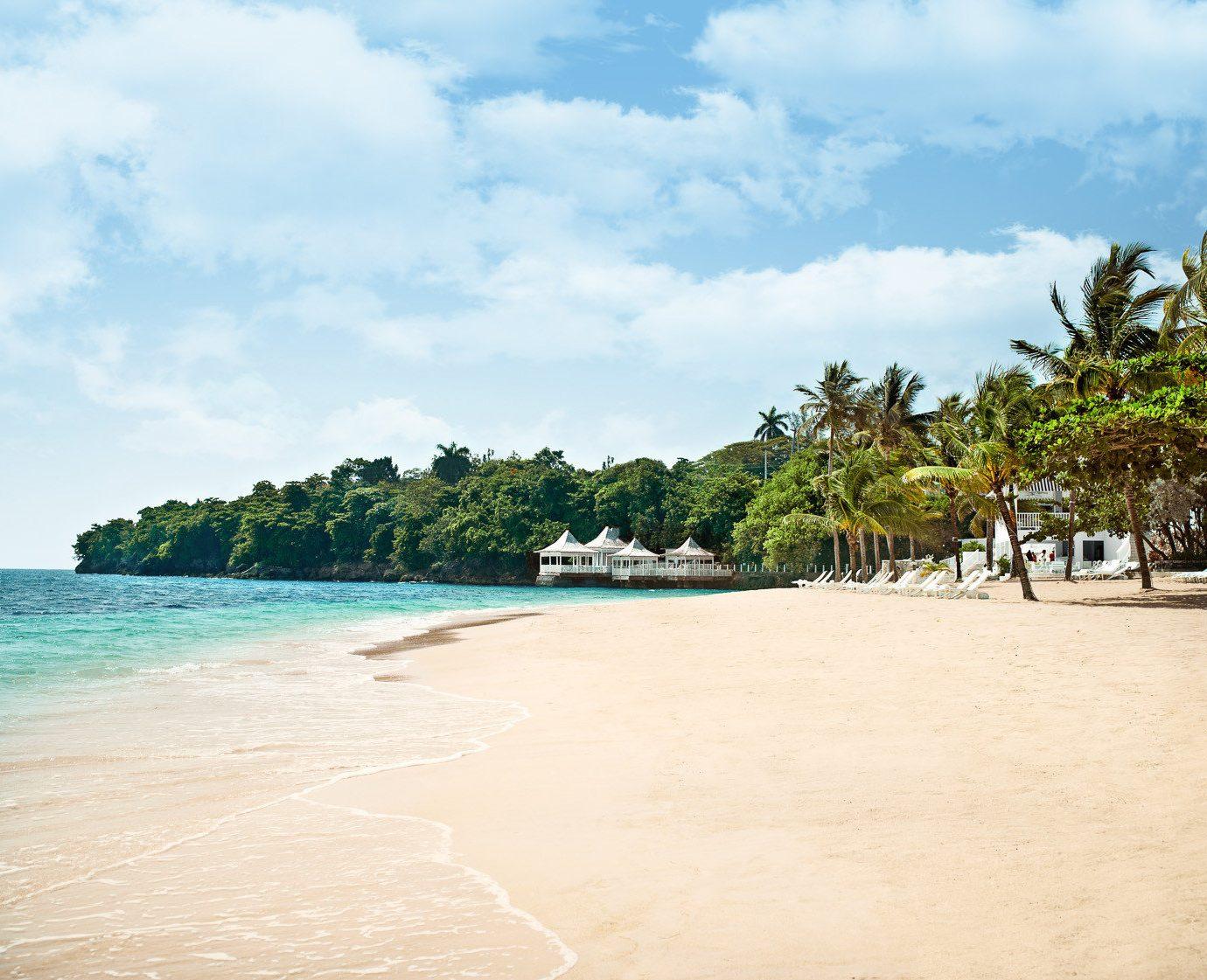 sky Beach water ground shore Sea Nature Ocean Coast caribbean tropics sand sandy arecales walkway day