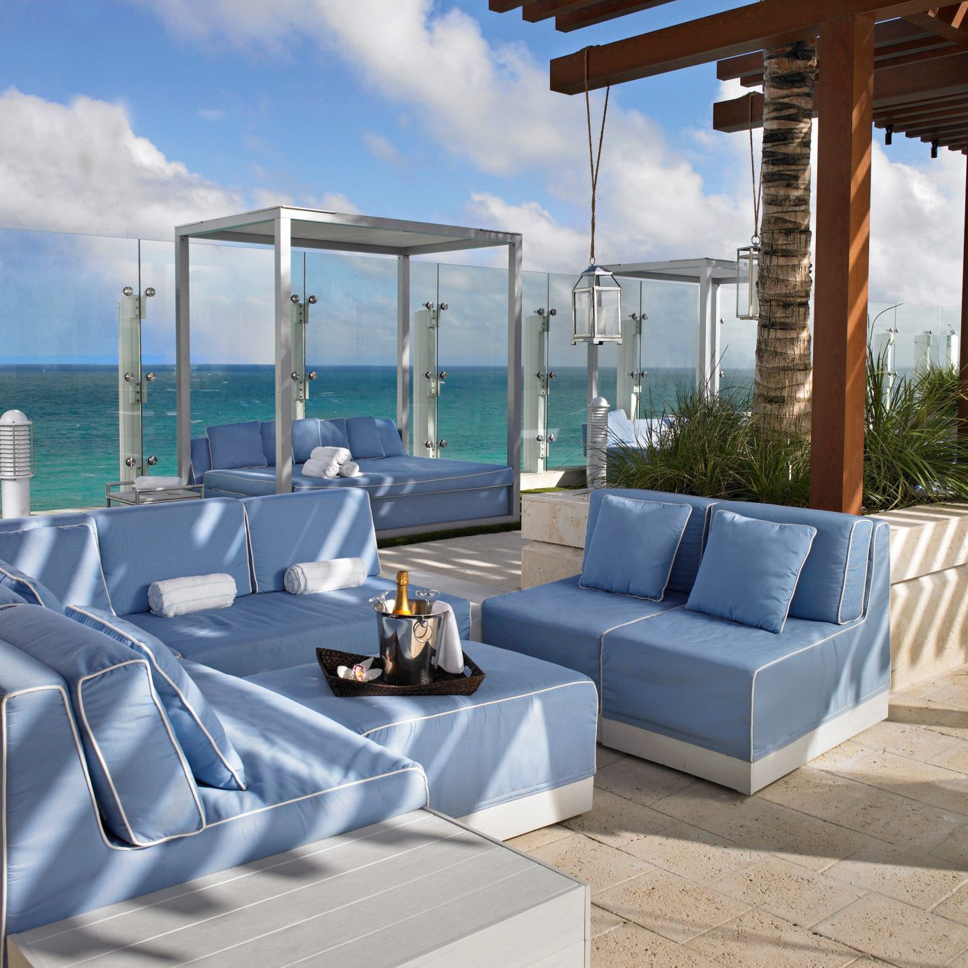 Beachfront Lounge Luxury Pool Rooftop Scenic views Waterfront sky property Resort swimming pool yacht Villa vehicle condominium outdoor structure passenger ship Boat living room day