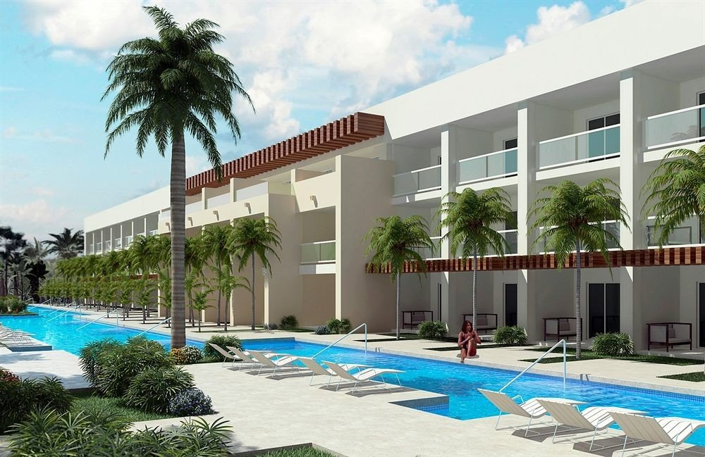 Beachfront Buildings Exterior Grounds Lounge Luxury Pool sky tree Resort condominium building property leisure plaza palm swimming pool leisure centre lawn Villa plant Garden mansion shade colonnade