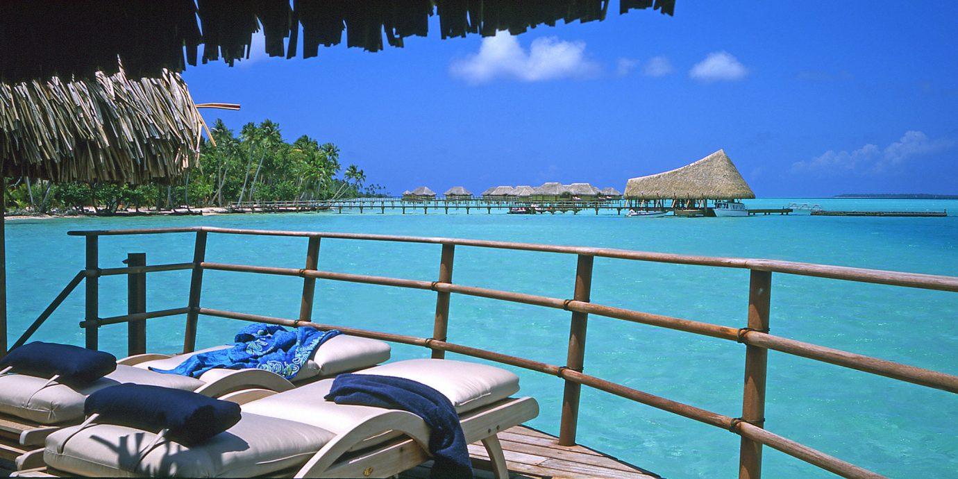 Beachfront Deck Scenic views Suite chair sky leisure property swimming pool caribbean Resort Ocean Sea row lawn lined Villa Lagoon overlooking
