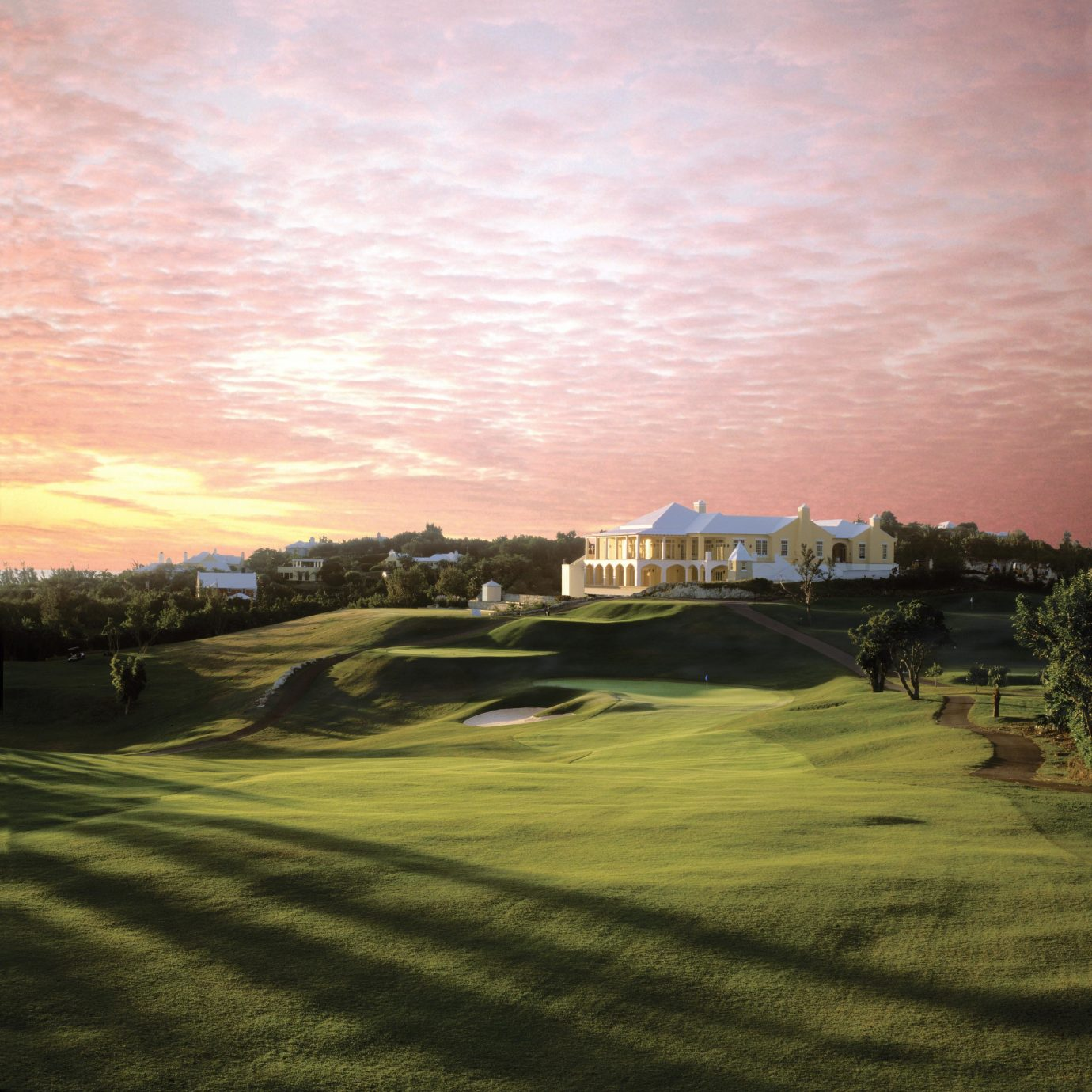 Beachfront Elegant Exterior Golf Grounds Hotels Island Scenic views Sport Sunset Tropical Waterfront sky grass structure sport venue golf course cloud field golf club Nature sports lawn dusk day