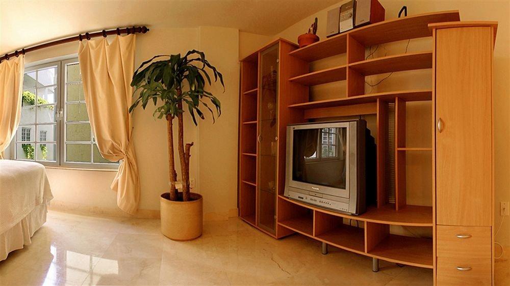 property cabinetry home hardwood living room cottage Bedroom