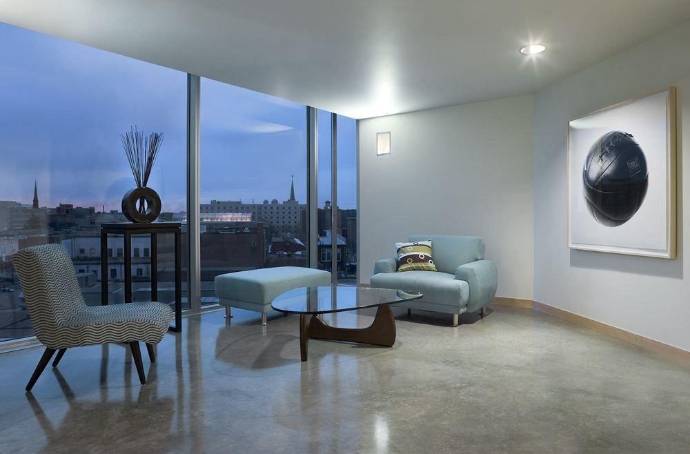 chair property living room condominium home flooring loft Bedroom