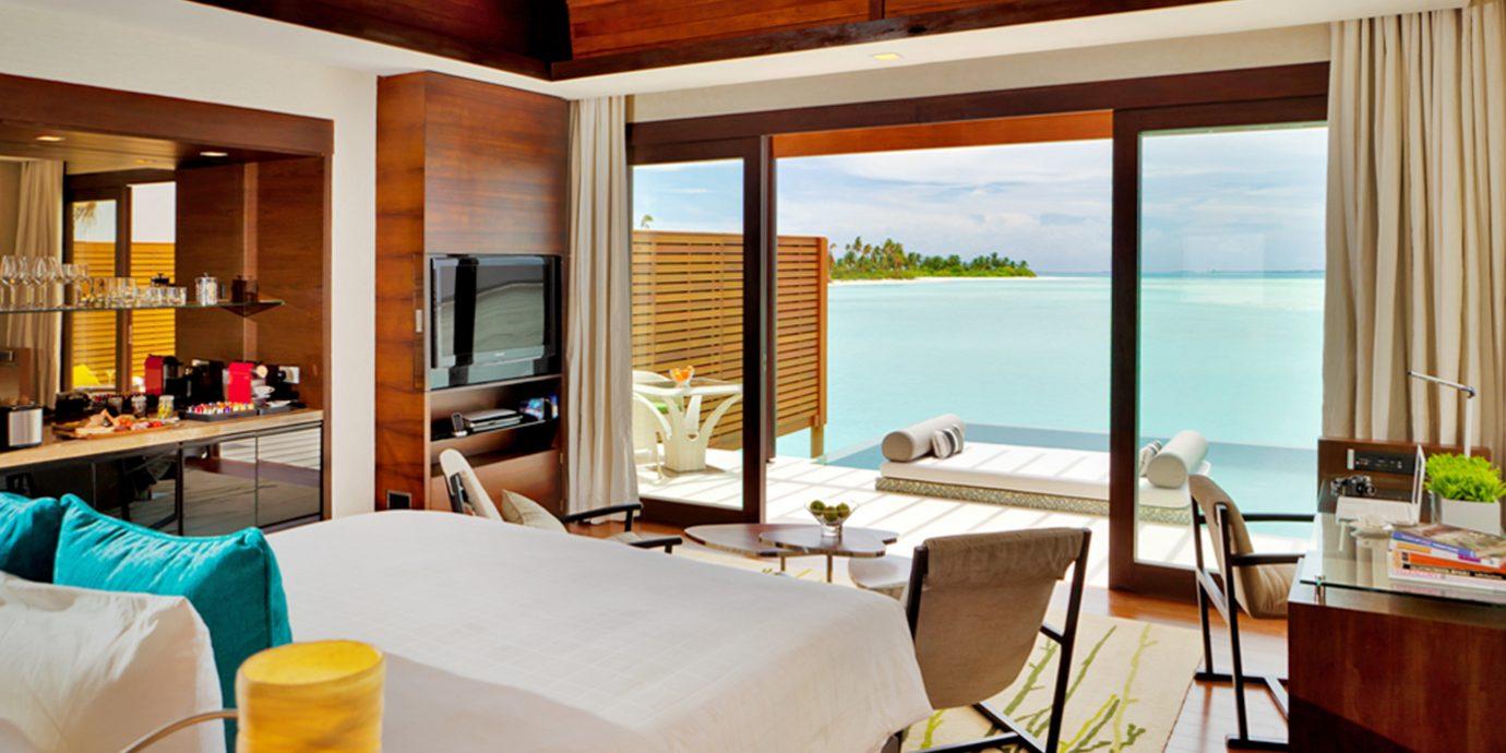 Bedroom Deck Elegant Luxury Modern Scenic views Suite Villa property living room home condominium Resort cottage overlooking
