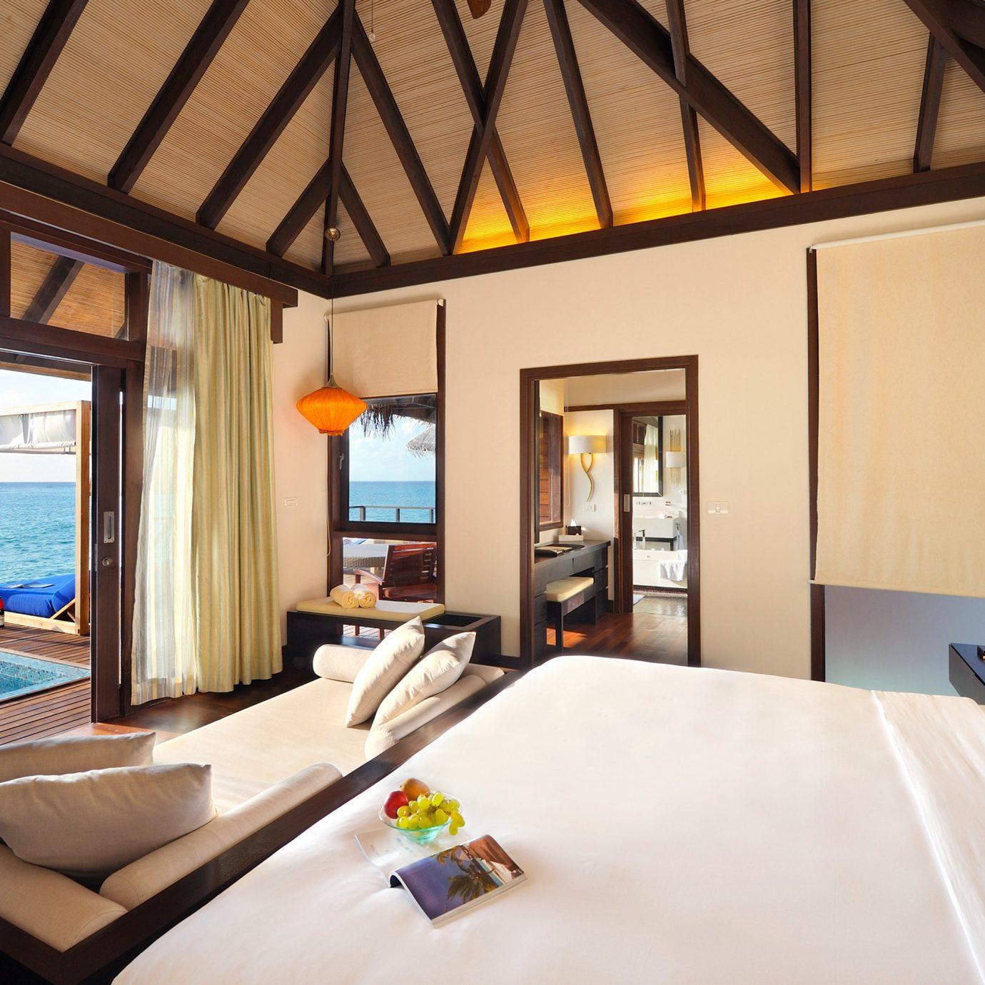 Bedroom Island Luxury Overwater Bungalow Romance Romantic Suite property Resort Villa living room home cottage pillow condominium