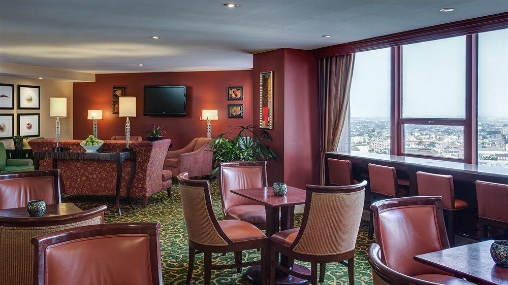 chair property Suite home living room Resort condominium rug Bedroom leather