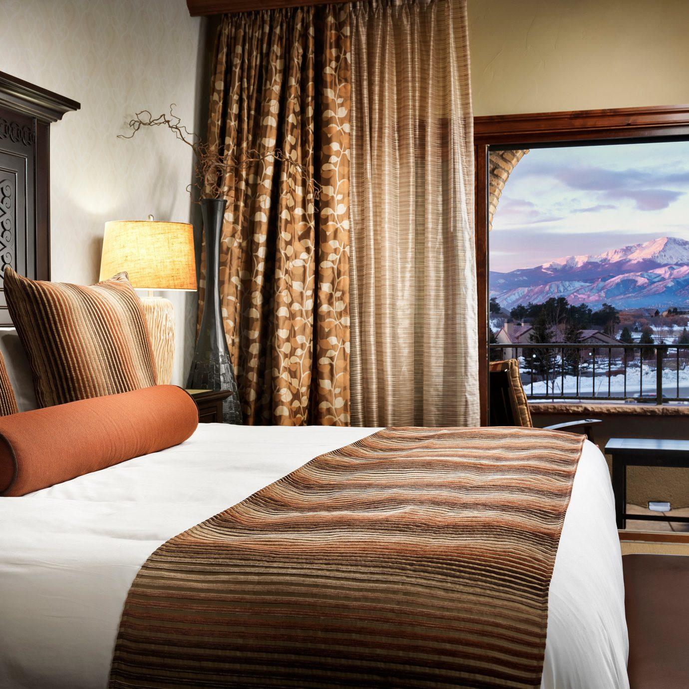 sofa property Bedroom Suite living room home condominium pillow window treatment curtain